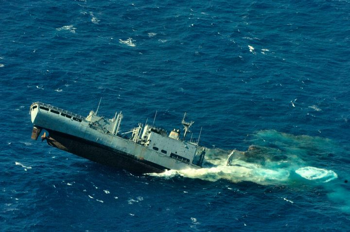 Ex-USNS Concord is used as a target vessel for Her Majesty's Canadian Ship Victoria (SSK 876) off Kauai, Hawaii, on July