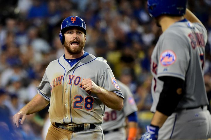 Daniel Murphy is thrilled after scoring in the fourth inning.