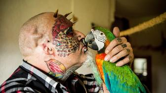 Ted Richards, 56, has had his ears cut off so he'd more closely resemble his beloved parrots.