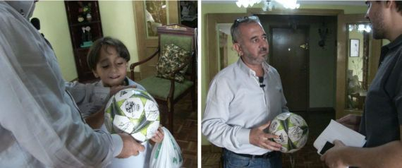 Abdul Mohsen and his son Zaid play with a ball signed by Real Madrid players.