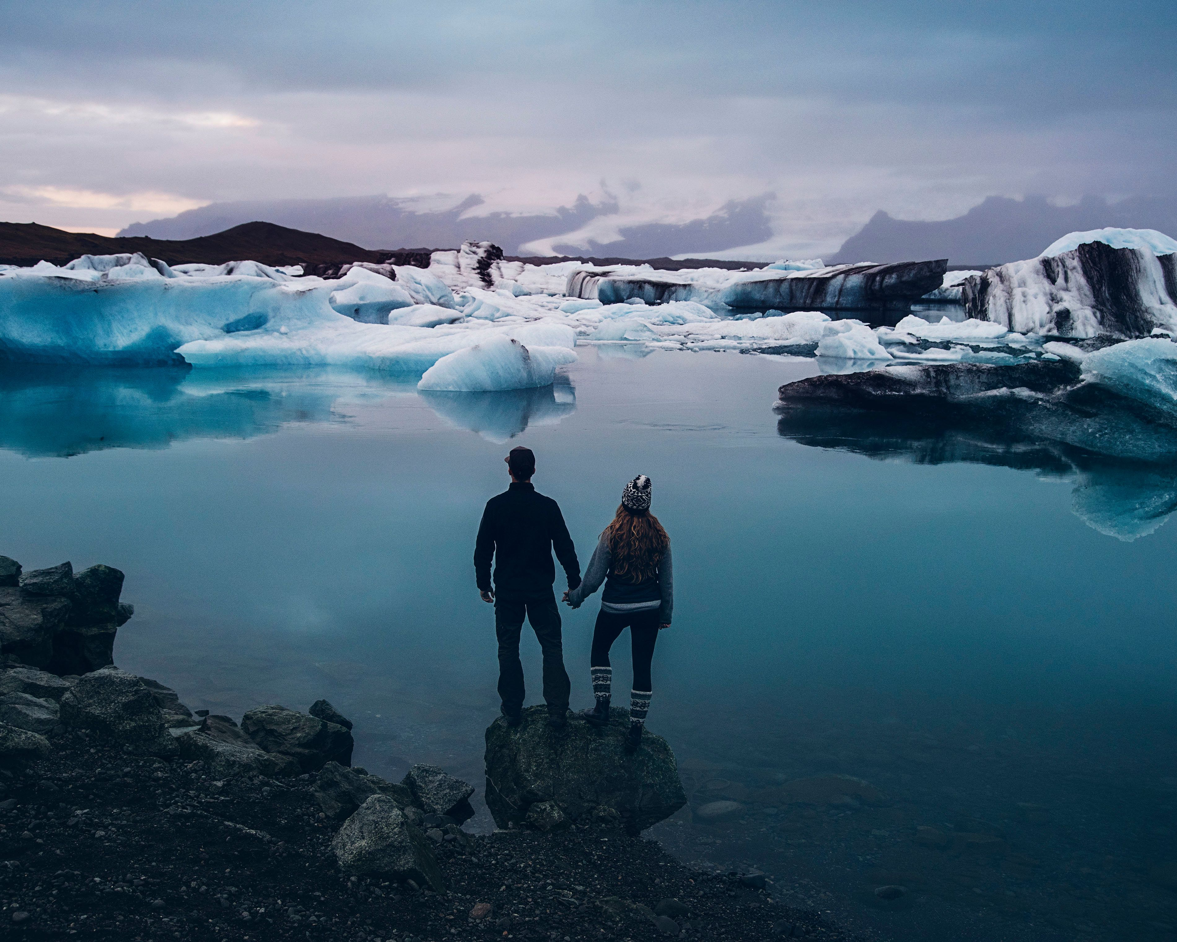 PIC BY TORY MOTH/CATERS NEWS - (PICTURED: Jeremy and Rachelle Garrett at A foggy morning at Jokulsarlon glacial lagoon) -  Th
