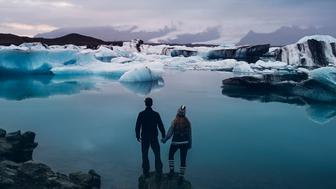 PIC BY TORY MOTH/CATERS NEWS - (PICTURED: Jeremy and Rachelle Garrett at A foggy morning at Jokulsarlon glacial lagoon) -  These incredible pictures of a wanderlust couple who travelled around Iceland to find their perfect wedding location are simply stunning. Shunning the idea of a traditional wedding, high school sweethearts Jeremy and Rachelle Garrett, from Ontario, Canada, planned the most unique and beautiful wedding ever. They had both always wanted to visit Iceland, so the loved-up pair jetted half way across the world and lived out of a van as they scouted out their dream wedding location. SEE CATERS COPY.