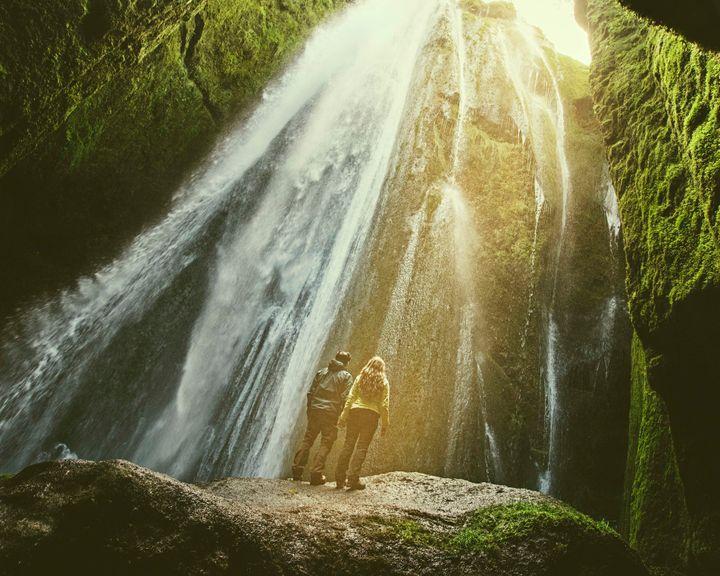 The couple atGljufrabui Waterfall in Iceland.