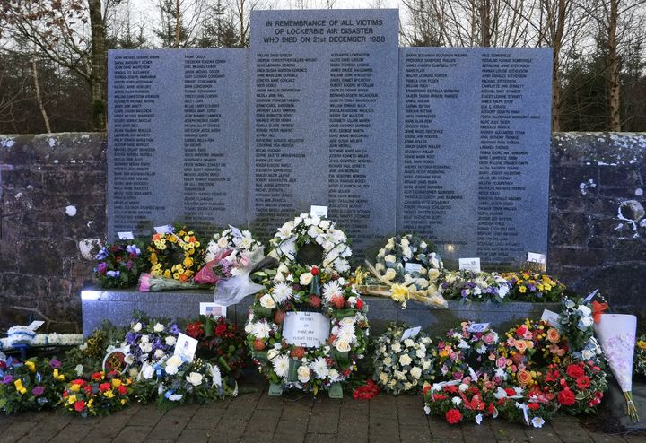 The Lockerbie air disaster memorial wall in Lockerbie, Scotland, is covered in wreaths following a memorial service to commem