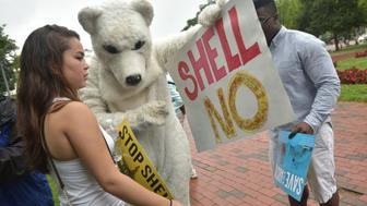 Demonstrators take part in the Shell No Day of Action  on July 18, 2015 to protest against arctic drilling during a rally at Lafayette Square across from the White House in Washington, DC. AFP PHOTO/MANDEL NGAN        (Photo credit should read MANDEL NGAN/AFP/Getty Images)