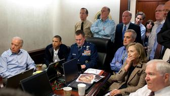President Barack Obama and Vice President Joe Biden, along with with members of the national security team, receive an update on the mission against Osama bin Laden in the Situation Room of the White House in Washington, D.C., May 1, 2011. Seated, from left, are: Brigadier General Marshall B. 'Brad' Webb, Assistant Commanding General, Joint Special Operations Command; Deputy National Security Advisor Denis McDonough; Secretary of State Hillary Rodham Clinton; and Secretary of Defense Robert Gates. Standing, from left, are: Admiral Mike Mullen, Chairman of the Joint Chiefs of Staff; National Security Advisor Tom Donilon; Chief of Staff Bill Daley; Tony Binken, National Security Advisor to the Vice President; Audrey Tomason Director for Counterterrorism; John Brennan, Assistant to the President for Homeland Security and Counterterrorism; and Director of National Intelligence James Clapper. Please note: a classified document seen in this photograph has been obscured. (Pete Souza/The White House/MCT via Getty Images)
