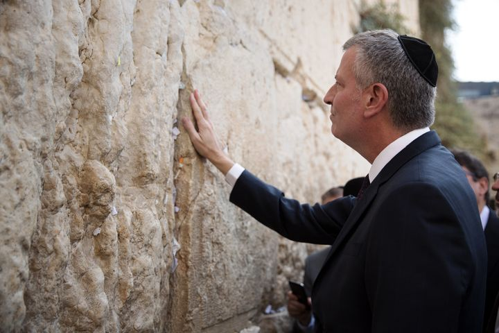 De Blasio prays after placing a wish paper at the Western Wall, Judaism's holiest site, in the old city of Jerusalem. October