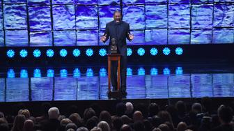 WASHINGTON, DC - OCTOBER 18: Eddie Murphy does a Bill Cosby impression during his speech as he accepts the Mark Twain Prize for American Humor at the Kennedy Center that honored Murphy on Sunday October 18, 2015 in Washington, DC. (Photo by Matt McClain/ The Washington Post via Getty Images)