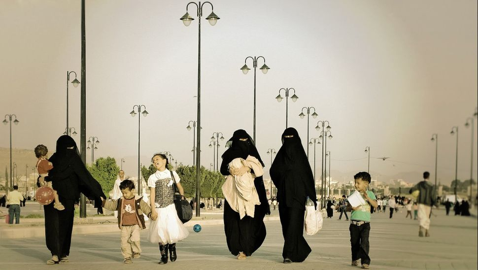 A family walks near the Saleh Mosque on Oct. 24, 2014.