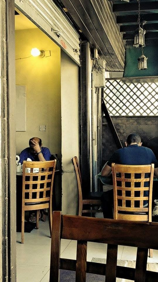 After a difficult night of heavy bombing, a breakfast bistro in Sanaa is filled with diners on April 13, 2015.