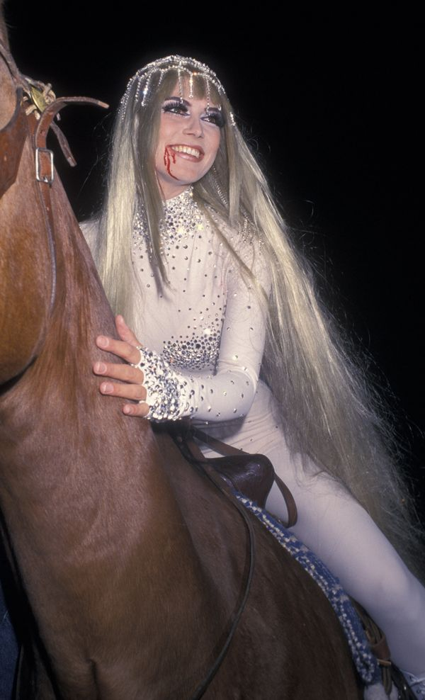 Heidi channeled Lady Godiva in a long, blond wig as she arrived on horseback to her second annual Halloween party.
