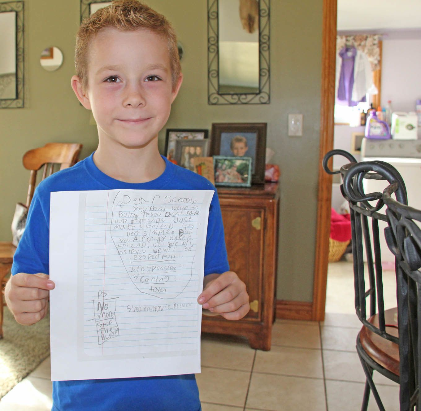 8 year old Nicolas Neesley shows his anti-bullying letter. Jennifer Coe-Harris photo