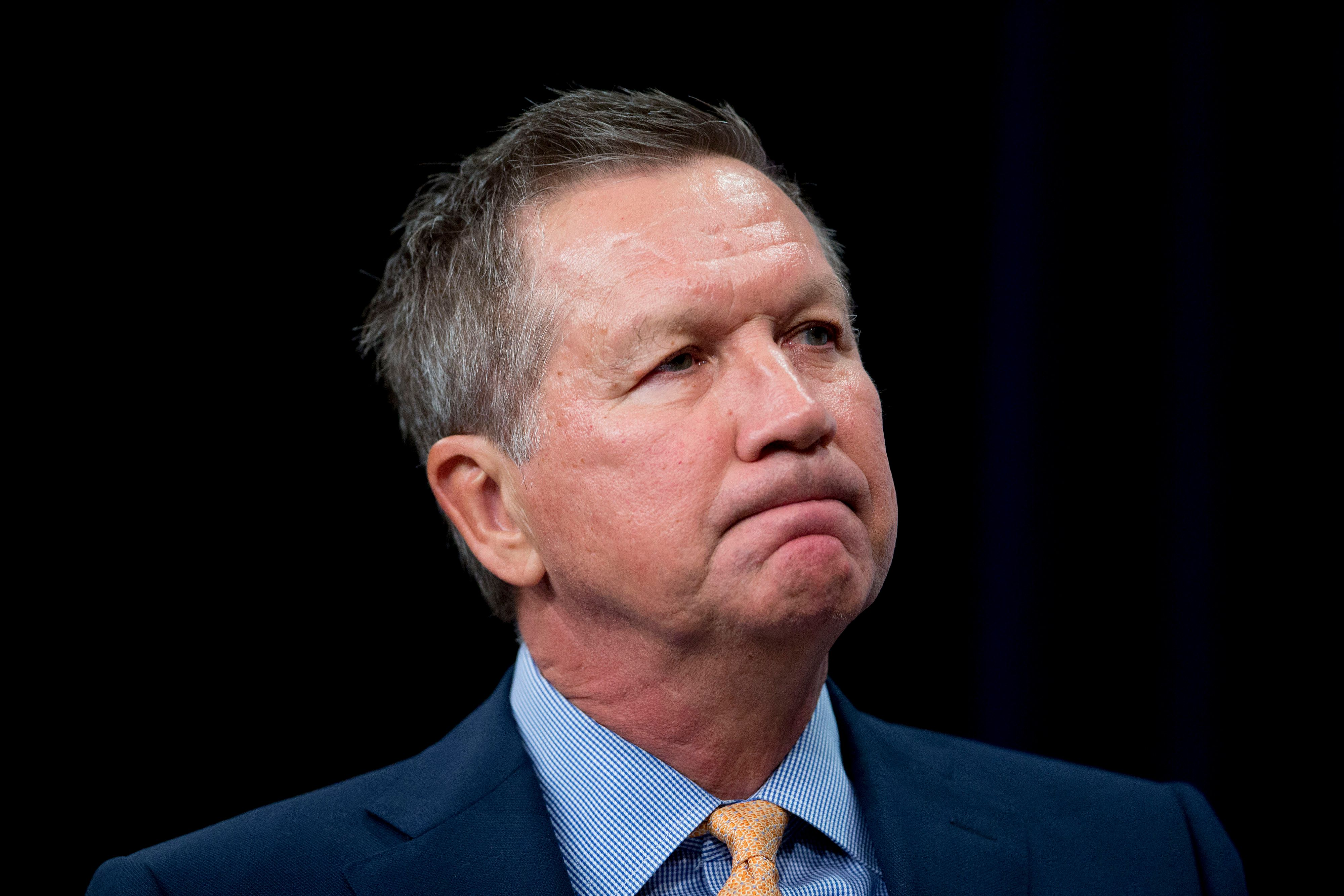 John Kasich, governor of Ohio and 2016 Republican presidential candidate, pauses during a U.S. Hispanic Chamber of Commerce interview at the Newseum in Washington, D.C., U.S., on Tuesday, Oct. 6, 2015. Kasich in Sept. hired Cory Crowley, a former aide to Senator Chuck Grassley of Iowa, to be his state director, and state Representative Mary Ann Hanusa, who worked for former President George W. Bush, as his state chairwoman. Photographer: Andrew Harrer/Bloomberg via Getty Images
