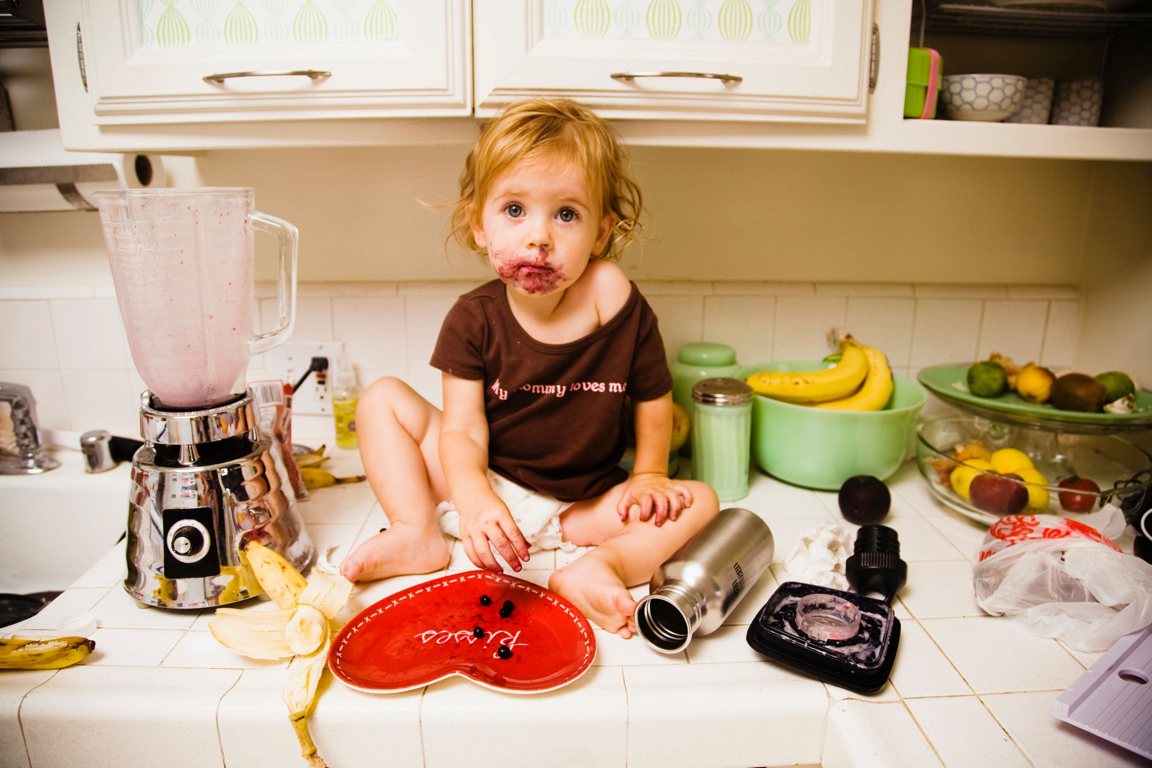 Messy child on kitchen counter