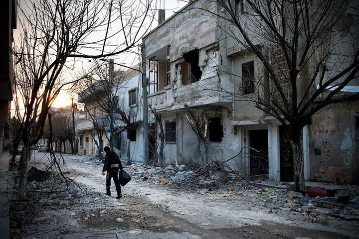 A boy walks amid destruction in the district of Baba Amr in Homs in February 2012.