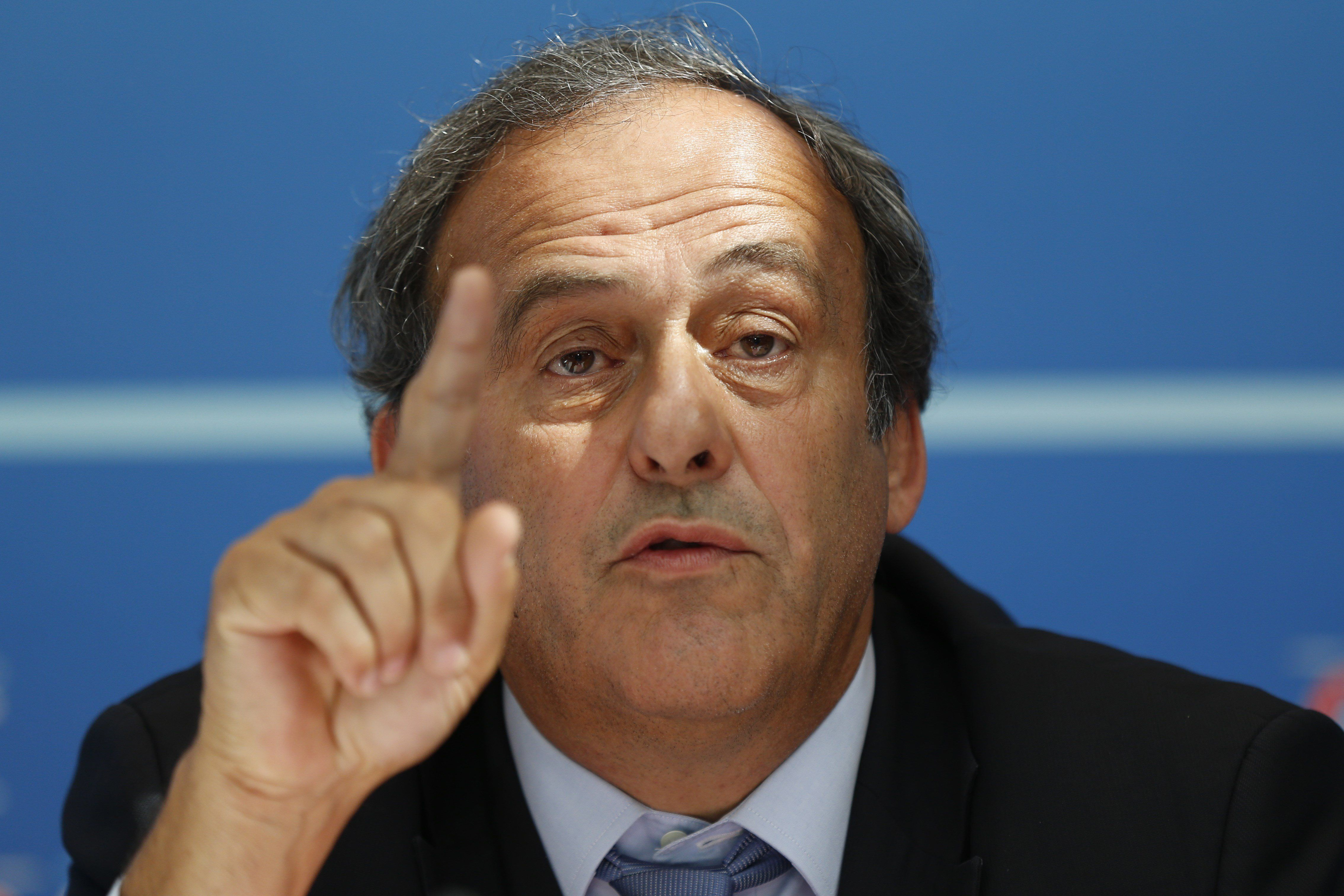 UEFA chief Michel Platini speaks during a UEFA press conference after the draw for the UEFA Europa League football group stage 2015/16 on August 28, 2015 in Monaco.  AFP PHOTO / VALERY HACHE        (Photo credit should read VALERY HACHE/AFP/Getty Images)