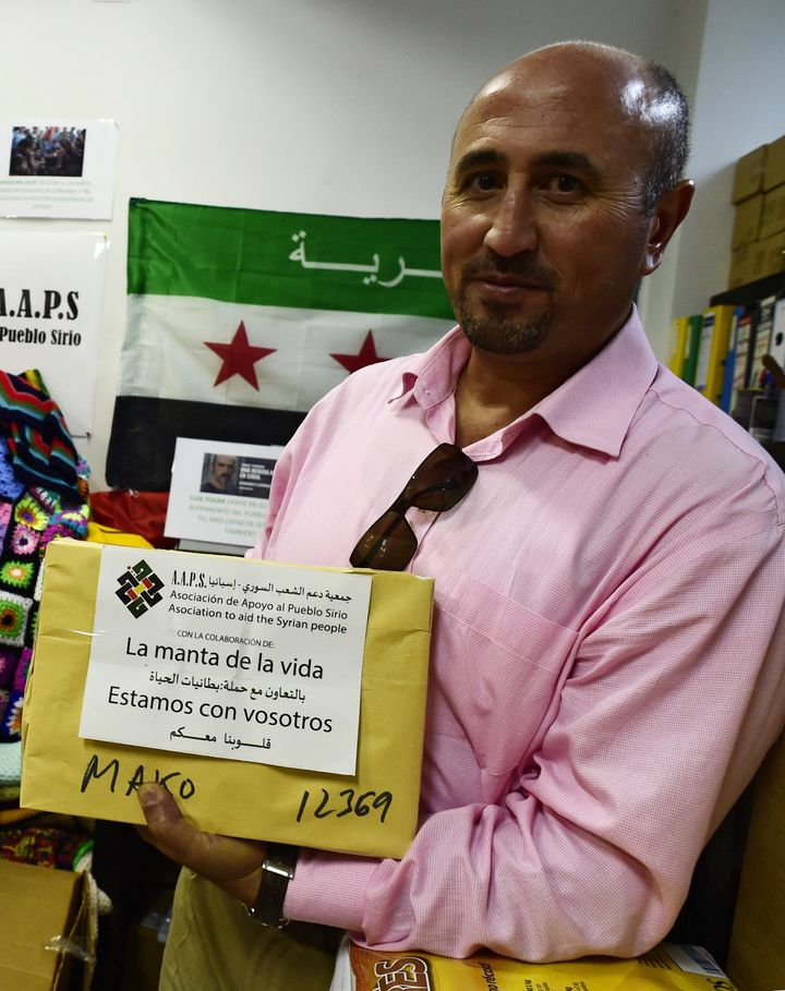 """Each blanket sent to Syria ispackaged with a label, in both Spanish and Arabic, reading """"We are with you."""""""