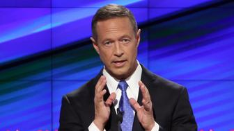 Martin O'Malley, former governor of Maryland, participates in the first Democratic presidential debate at the Wynn Las Vegas resort and casino in Las Vegas, Nevada, U.S., on Tuesday, Oct. 13, 2015. While tonight's first Democratic presidential debate will probably lack the name-calling and sharp jabs of the Republican face-offs, there's still potential for strong disagreements between the party's leading contenders. Photographer: Josh Haner/Pool via Bloomberg