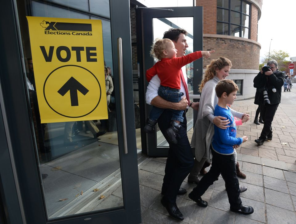 Liberal Leader Justin Trudeau and family leave a polling station after voting in Montreal, Oct. 19, 2015.
