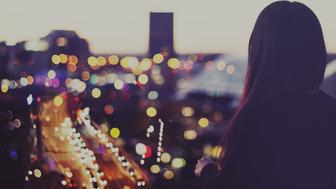 Girl Looking at City Lights at Night