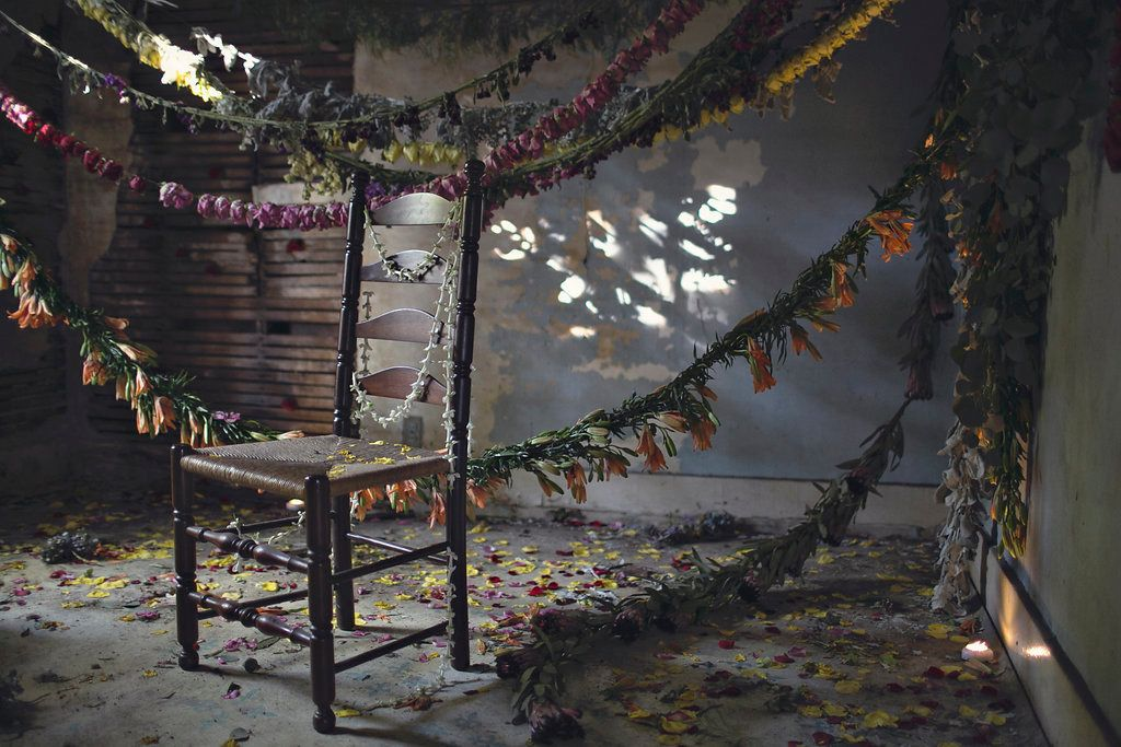 A scene from Flower House, a floral installation in an abandoned house in Detroit.