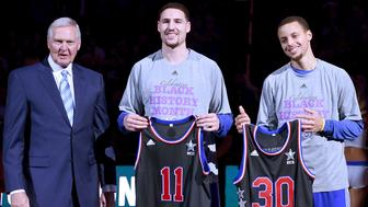 OAKLAND, CA - FEBRUARY 04:  Klay Thompson #11, Stephen Curry #30 and executive Jerry West of the Golden State Warriors poses with the players Allstar jersey's prior to the game against the Dallas Mavericks at ORACLE Arena on February 4, 2015 in Oakland, California.  (Photo by Thearon W. Henderson/Getty Images)