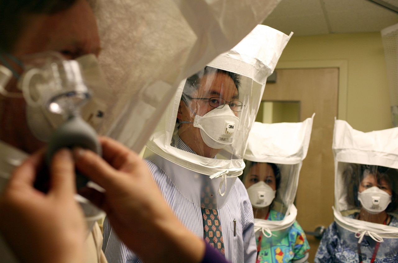 Doctors and nurses in Oakland, California, test respiratory hoods used when they suspect a patient has tuberculosis or the swine flu.