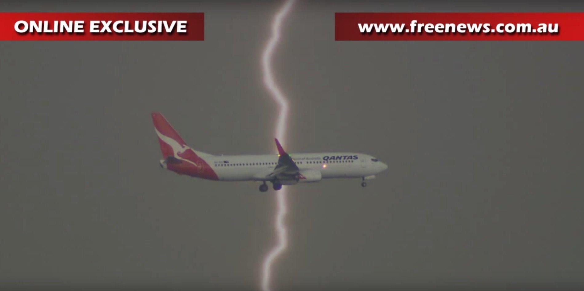 Lightning strikes near a Qantas jet.