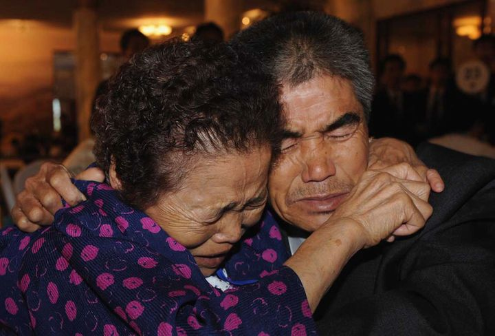 Relatives cry as they bid farewellto each other at a family reunion event in North Korea in 2009.
