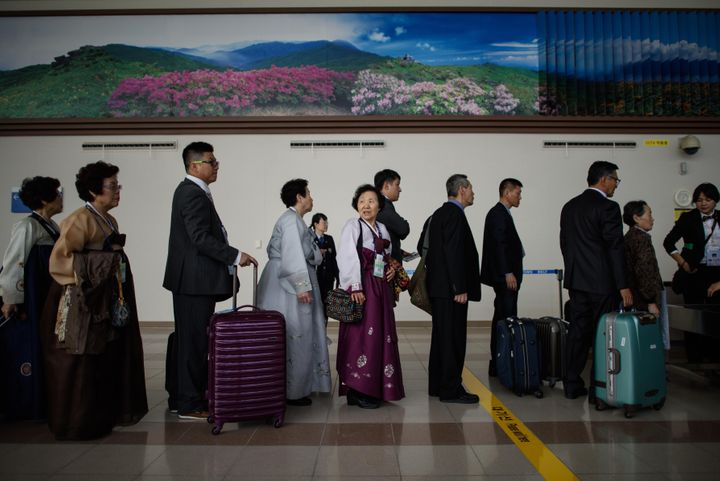 South Koreans chosen to attend the family reunion event in North Korea wait to enter the Demilitarized Zone separating the tw