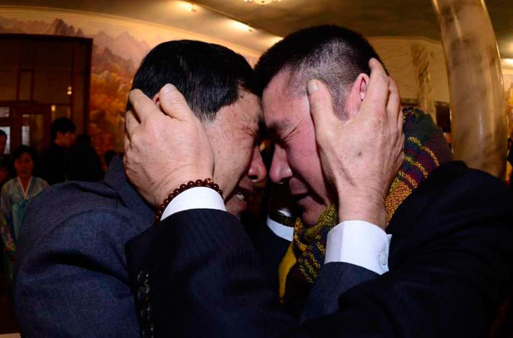 South Korean Park Yang-gon, left, meets his North Korean brother Park Yang-soo during a 2014 family reunion event in North Ko