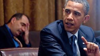 US President Barack Obama speaks alongside White House Senior Advisor David Axelrod (L) during a meeting with Congressional leadership in the Cabinet Room at the White House in Washington, DC, July 27, 2010. AFP PHOTO / Saul LOEB (Photo credit should read SAUL LOEB/AFP/Getty Images)