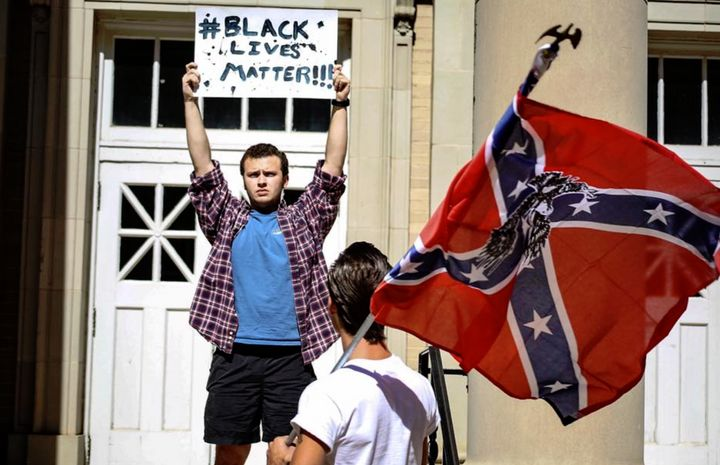 """An Ole Miss student responds toa KKK counter-rally on campus with a """"Black Lives Matter"""" sign."""