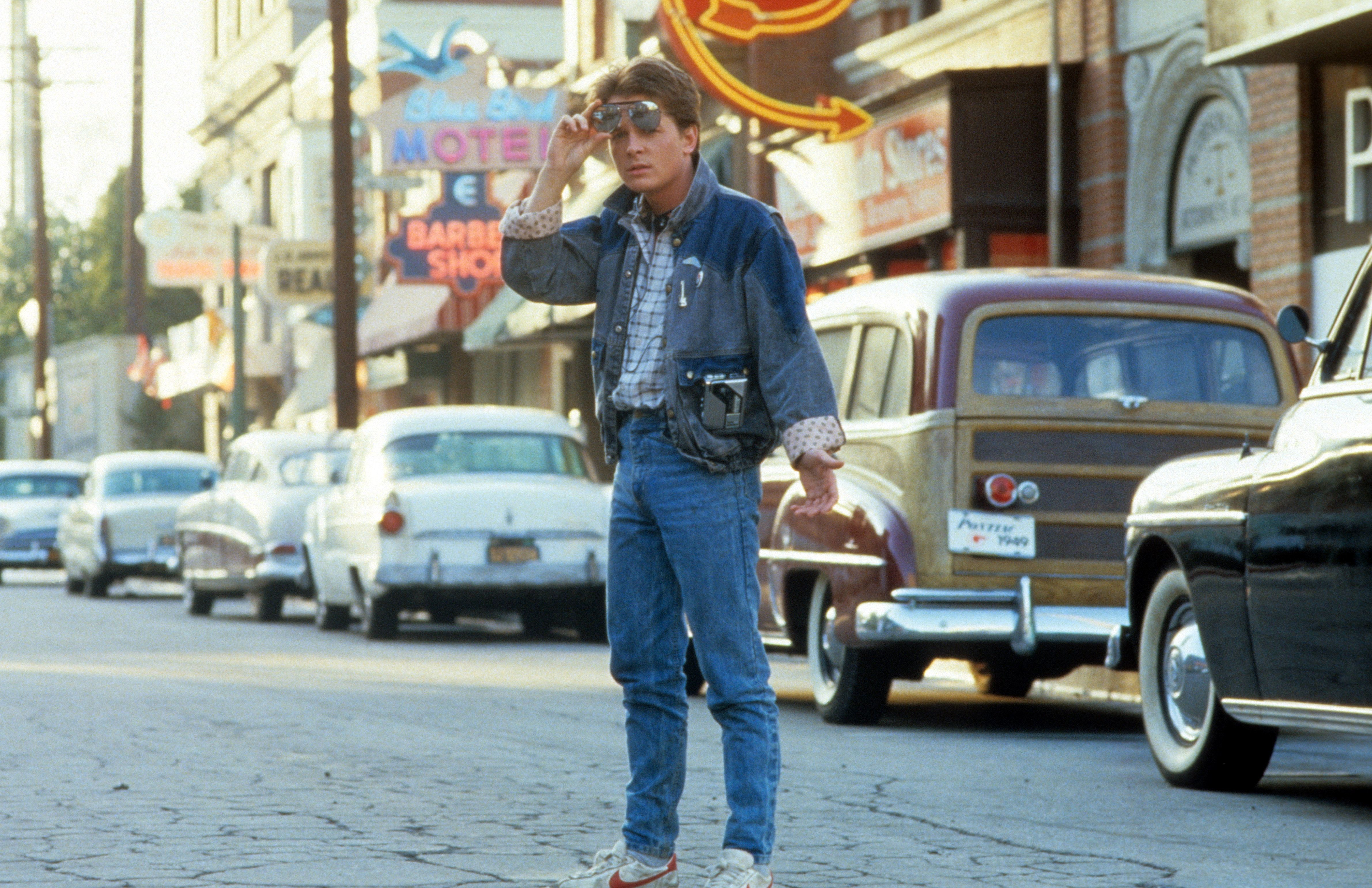 Michael J Fox walking across the street in a scene from the film 'Back To The Future', 1985. (Photo by Universal/Getty Images)