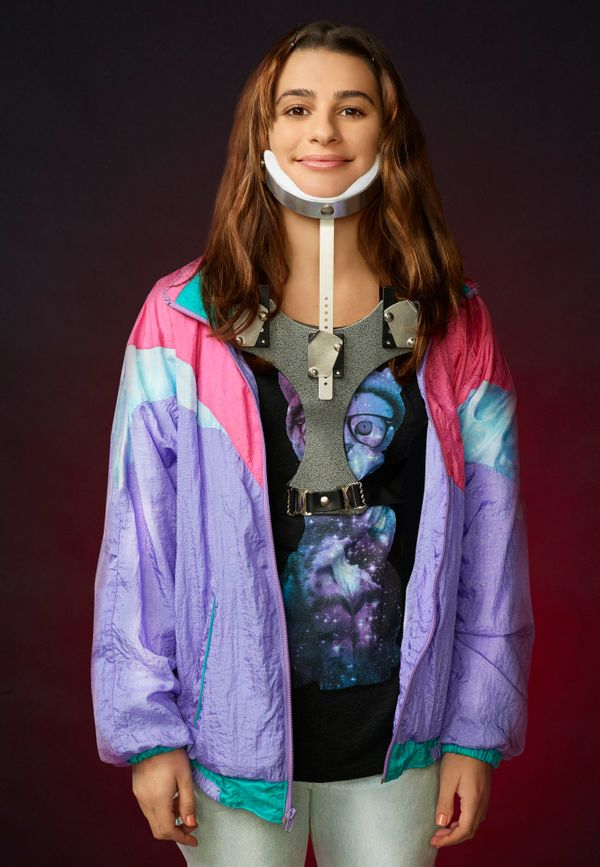 Before her makeover, Hester let her neck brace define here. She hid behind '90s day-glo ski jackets and cosmic cat shirts. Al
