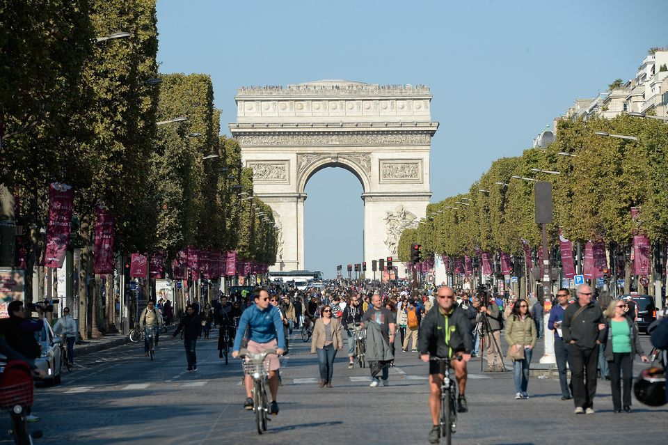 A view of the crowd on the Champs Elysees with the Arc de Triomphe on the background during the car free day on September 27,