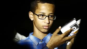 Ahmed Mohamed (R), a 14-year-old US Muslim teenager of Sudanese origin who became an overnight sensation after a Texas teacher mistook his homemade clock for a bomb, speaks to the press before his meeting with Sudanese President Omar al-Bashir, in Khartoum on October 14, 2015.  The son of Sudanese immigrants who live in a Dallas suburb, the young robotics fan brought in a home-made clock to impress a new teacher at MacArthur High Schoo was taken away from school in handcuffs and briefly arrested by police. Police later said they have determined that Mohamed had no malicious intent and it was 'just a naive set of circumstances.' AFP PHOTO / ASHRAF SHAZLY        (Photo credit should read ASHRAF SHAZLY/AFP/Getty Images)