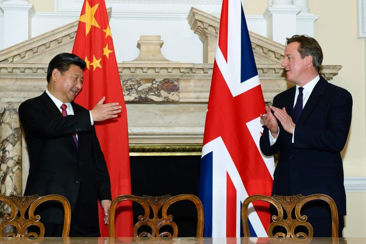 Chinese President Xi Jinping and British Prime Minister David Cameron celebrate the Chinese leader's four-day visit to the U.
