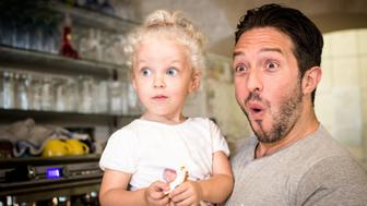 Cute blond girl (two years old) and her father making funny astonished faces.