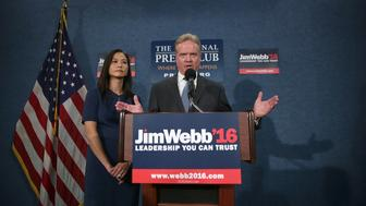 WASHINGTON, DC - OCTOBER 20:  Former U.S. Sen. Jim Webb (D-VA) speaks as his wife Hong Le Webb listens during a news conference at the National Press Club October 20, 2015 in Washington, DC. Sen. Webb announced that he is dropping out of the Democratic presidential race.  (Photo by Alex Wong/Getty Images)