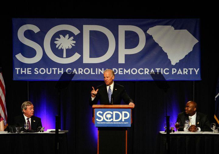 Joe Biden addresses the South Carolina Democratic Party as formerDemocratic Chairman, Dick Harpootlian, left, looks on.