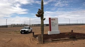 ELOY, AZ - JULY 30: A cactus and sign mark the entrance to the Eloy Detention Facility for illegal immigrants on July 30, 2010 in Eloy, Arizona. Most immigrants at the center, operated by the Corrections Corporation of America (CCA), are awaiting deportation or removal and return to their home countries, while some are interned at the facility while their immigration cases are being reviewed. The U.S. Immigration and Customs Enforcement (ICE), in Arizona holds almost 3,000 immigrants statewide, all at the detention facilities in  Eloy and nearby Florence. Arizona, which deports and returns more illegal immigrants than any other state, is currently appealing a judge's ruling suspending controversial provisions of Arizona's immigration enforcement law SB 1070.  (Photo by John Moore/Getty Images)