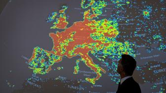 A man stands in front of a picture displaying activities of a so-called 'botnet' during a workshop on computer and cyber crimes hosted by the Hessian ministry of justice in frankfurt am Main, central Germany, on July 31, 2015. A botnet is a net of infected computers often used to send repetitive tasks or spam mails. AFP PHOTO / DPA / BORIS ROESSLER  GERMANY OUT        (Photo credit should read BORIS ROESSLER/AFP/Getty Images)