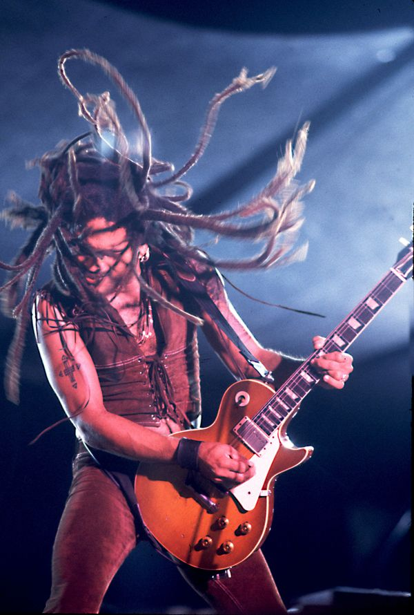 We're feeling the short 'fro Lenny Kravitz sports nowadays, but his dreadlocks were mesmerizing back in the day.