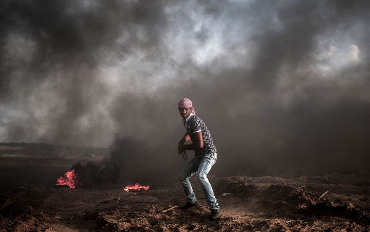 A Palestinian protester is seen during a demonstration against Israeli Government's violations at Al-Aqsa Mosque, on October