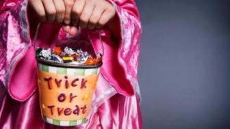 Girl holding Halloween trick or treat bucket