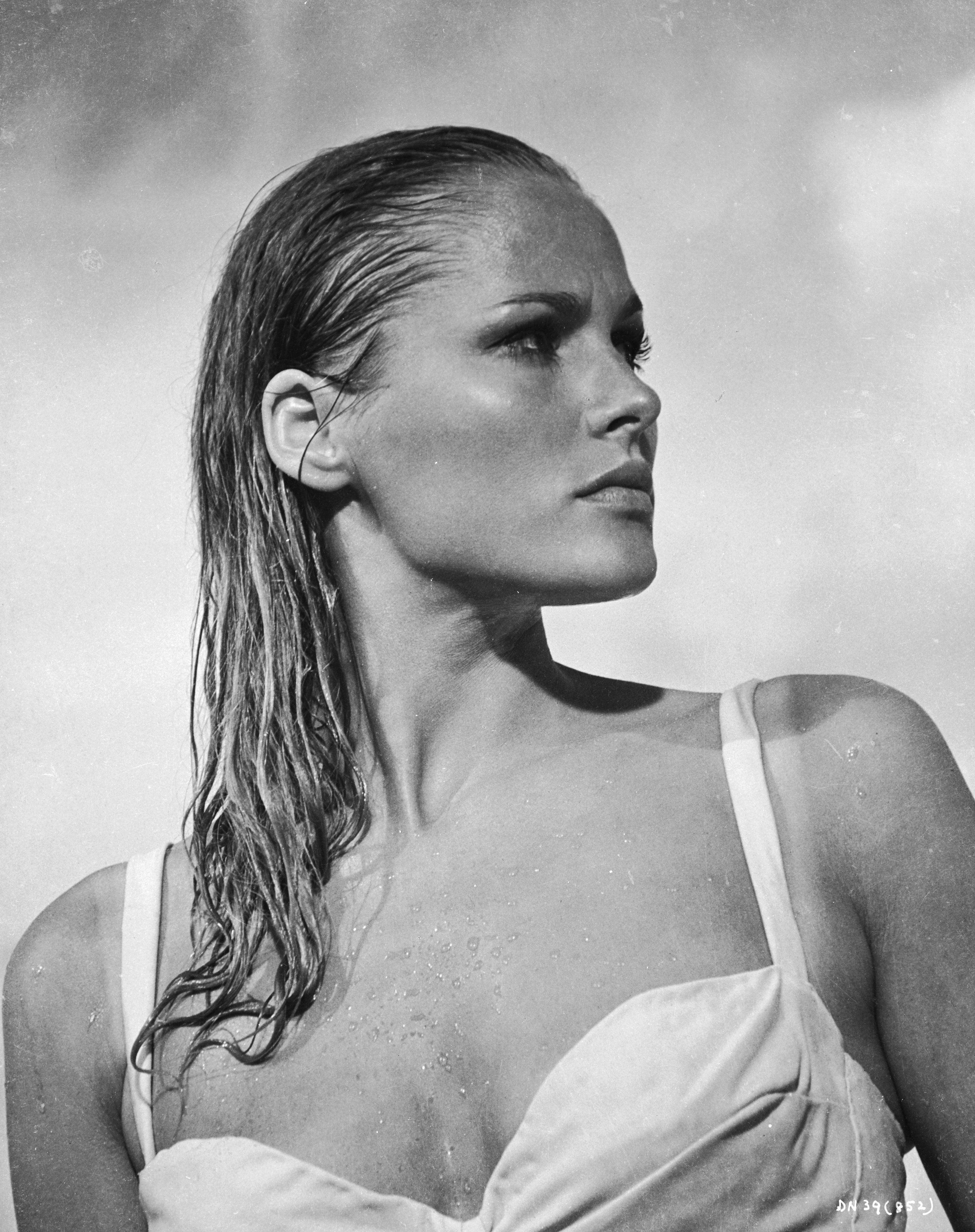 1962:  Glamorous Swiss actress Ursula Andress as Honey Ryder in a scene from the first James Bond movie 'Dr No'.  (Photo via John Kobal Foundation/Getty Images)