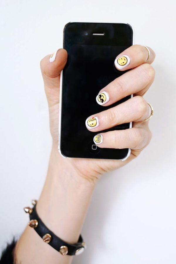 """<a href=""""http://www.abeautifulmess.com/2015/01/emoji-nail-decal-diy.html"""" target=""""_blank"""">Get expressive with this beyond ado"""