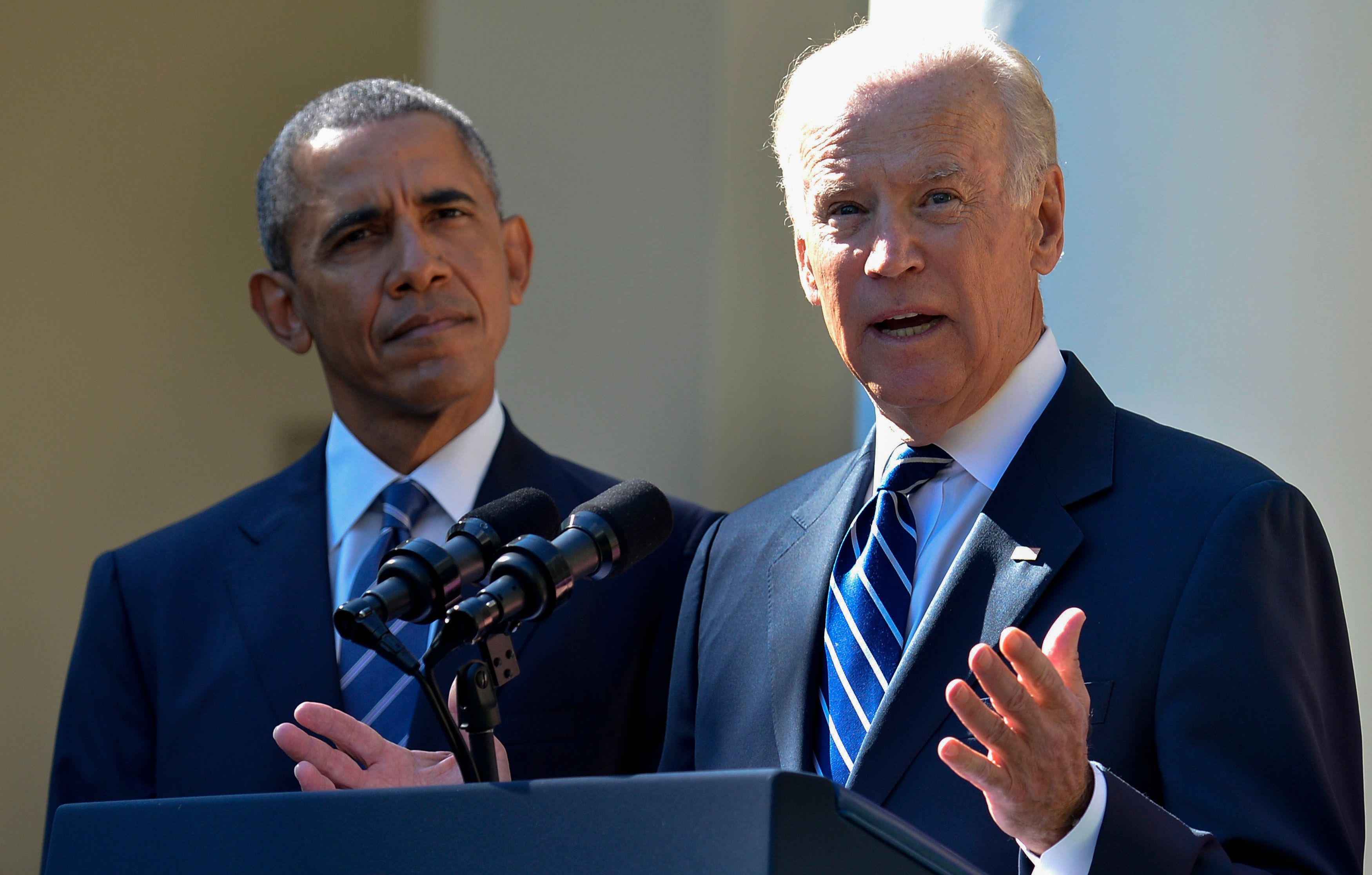 U.S. Vice President Joseph 'Joe' Biden, right, speaks in the Rose Garden of the White House with U.S. President Barack Obama in Washington, D.C., U.S., on Wednesday, Oct. 21, 2015. Vice President Biden won't seek the Democratic presidential nomination in 2016, ending months of deliberation and speculation and clearing the path for Hillary Clinton. Photographer: Mike Theiler/Pool via Bloomberg