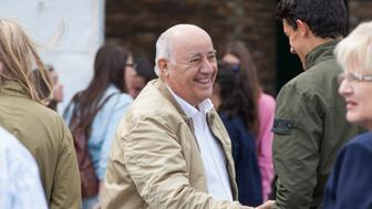 A CORUNA, SPAIN - JULY 27: Amancio Ortega, owner of Zara empire, meets some friends at CSI Casas Novas Horse Jumping Competition 2013 near Arteixo on July 27, 2013 in A Coruna, Spain.  (Photo by Xurxo Lobato/Getty Images)